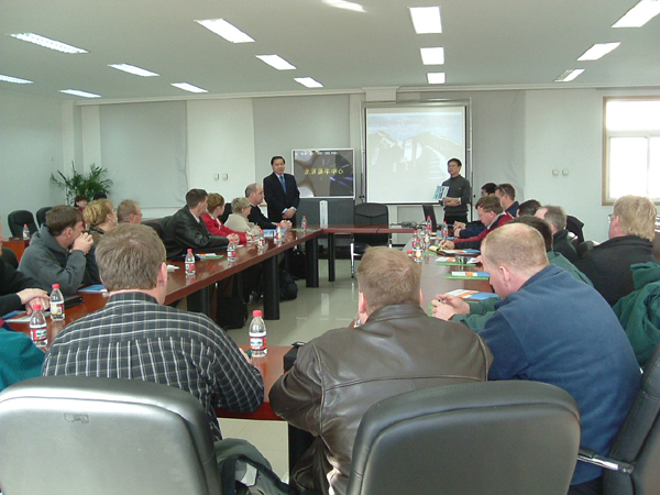 gusets hear a briefing of Beijing Dairy Cattle Center