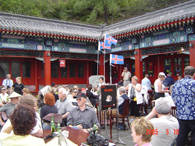 Guests have a rest in a coffee room under the Great Wall.
